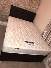 white and gray floral bed mattress with black bed Birmingham