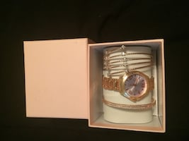 Rose gold watch and bangles