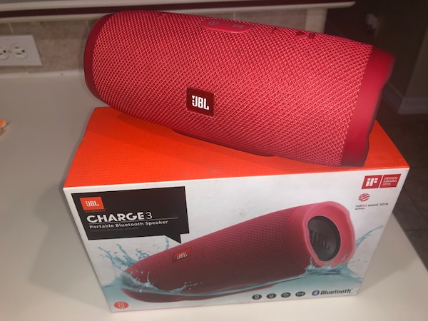 red JBL Charge 3 with box
