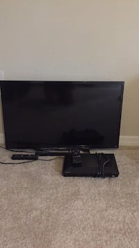 black flat screen TV with remote Tarpon Springs