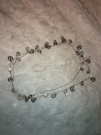 silver-colored peace sign beaded necklace