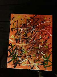 orange, green, black, and red abstract painting