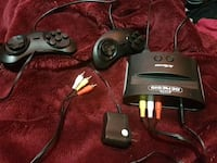 Sega Genesis with built in games, controllers, and all cords as seen. London, N5Z 2H7