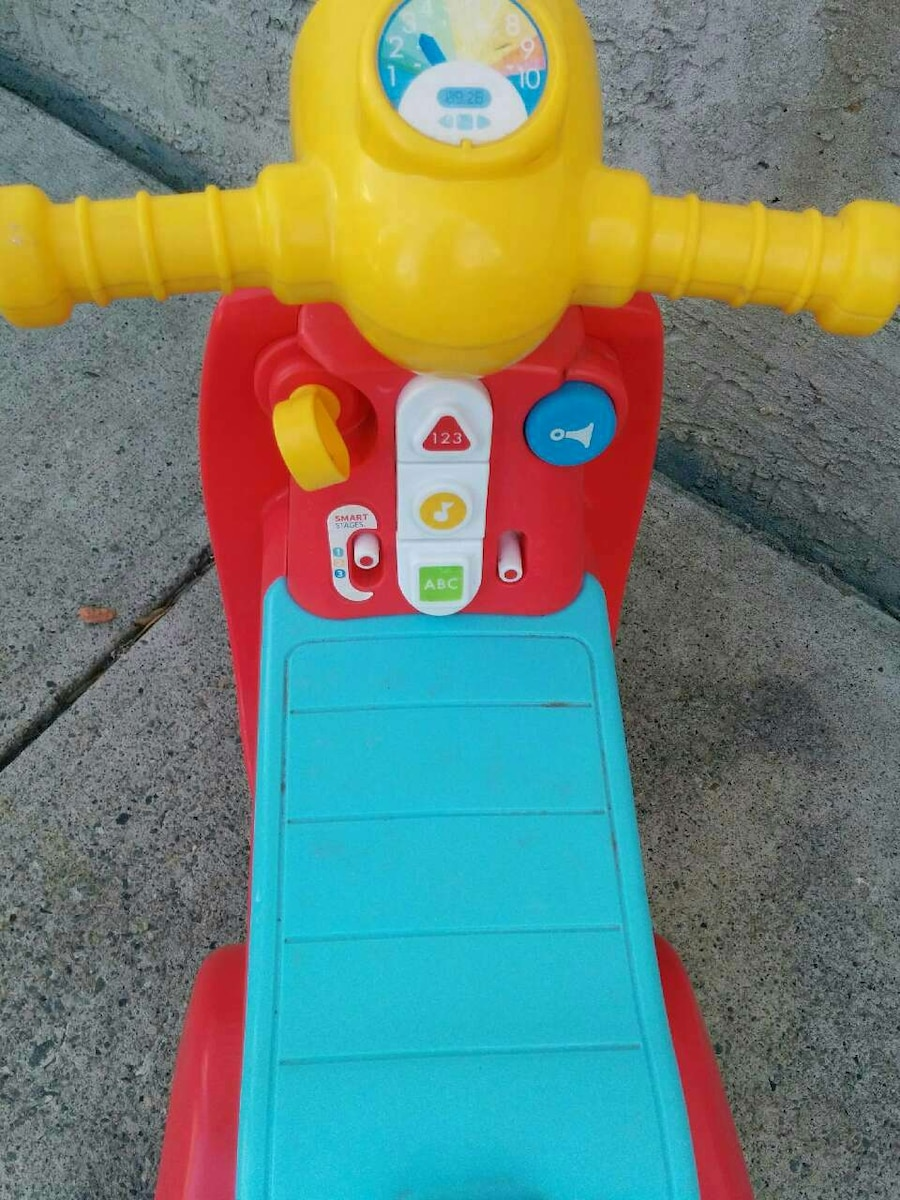 red, yellow, and blue activity ride on