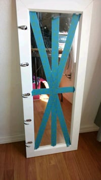 Cute mirror with several hanging hooks