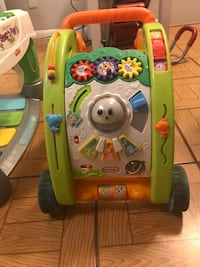 green and yellow Fisher-Price activity walker 758 mi