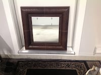 3 Leather framed mirrors