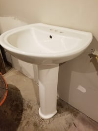 White pedestal sink with brush nickel faucet. In great shape Arlington, 22204