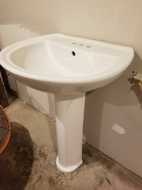 White pedestal sink with brush nickel faucet. In great shape 4bc301ab-03ee-4dd2-ad79-e1998560df7a