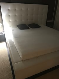 White Leather Bed with High Headboard and Wood Grain Trim. The pleather on the bed has chipped off but the structure is in great conditions.  New Brunswick, 08901