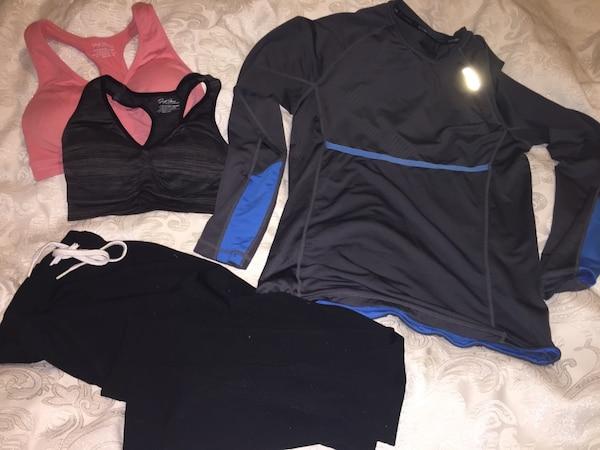 two pink and black sports bras and black rashguard