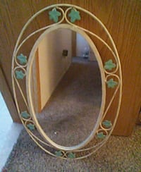 Oval mirror with flowers around mirror Las Vegas, 89128