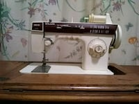 white and brown Singer electric sewing machine Covington, 41011