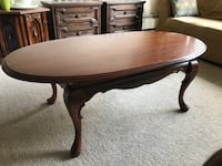 oval brown wooden coffee table Burnaby, V5E 1H7