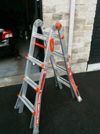 red and gray metal ladder Laval, H7A 1Z1