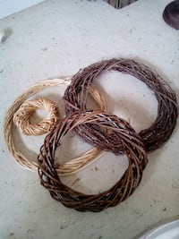 three brown wicker wreaths