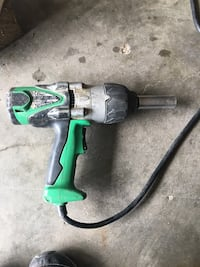 Green and black corded power tool