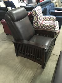 Brown leather chair with wood arms