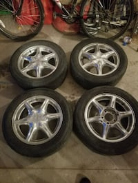 chrome 6-spoke vehicle wheel with tire Waterford