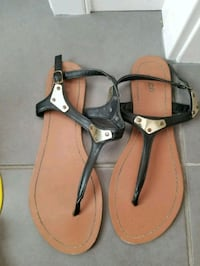 pair of brown-and-black leather sandals Calgary, T3M 1Z4