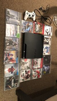 Black sony Playstation 3 with 17 games + controller   515 km