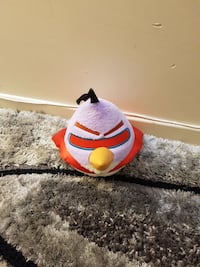 purple, red, and yellow Angry Bird plush toy