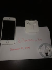 silver iPhone 6 with charger and EarPods 64 km