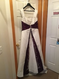 Soft ivory and royal purple wedding gown