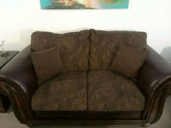 brown and beige floral loveseat