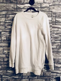 white crew-neck sweater with side zipper detailing