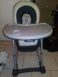 baby's white and black high chair West Palm Beach, 33407