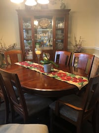 Table with leaflet, 6 chairs and china hutch