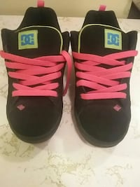 pair of black-pink-and-green DC sneakers