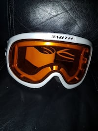 white and brown Smith snow goggles