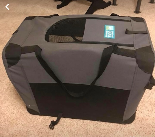 Black and gray travel cot