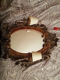 oval mirror with brown wooden frame
