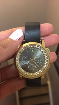 round gold-colored chronograph watch with black leather strap Calgary, T3P 1G8