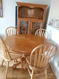 oval brown wooden table with six chairs dining set Mississauga, L5B 4G7