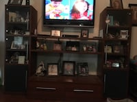 Flat screen television with brown wooden tv hutch Bakersfield, 93313
