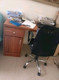 brown wooden desk with black rolling chair Bengaluru, 560043