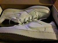 pair of white Nike low top sneakers in box Hamilton