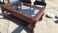 brown wooden framed glass top coffee table Bakersfield, 93313