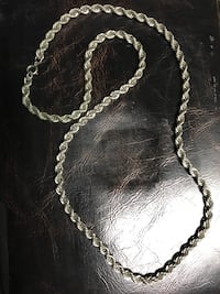 Silver-colored rope chain necklace....