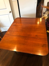 """Vintage drop leaf maple table. 54"""" with both ends unfolded. 2 chairs. Glenarden, 20706"""
