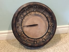 Round brown wooden framed analog wall clock