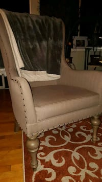 brown fabric sofa chair with throw pillow Victoria, V8V 4L4
