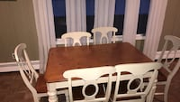 brown wooden table with chairs New Rochelle, 10804