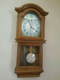 brown wooden framed pendulum clock 20 km