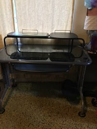 Metal desk with 'Leda' tempered glass. $50.00 or best cash offer. Cleveland, 37323