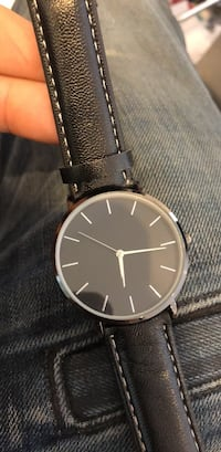 round black analog watch with black leather strap Laval, H7E 2P8